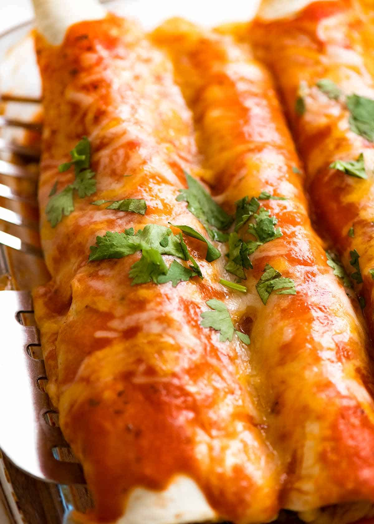 Close up of Chicken Enchiladas in a baking dish, fresh out of the oven