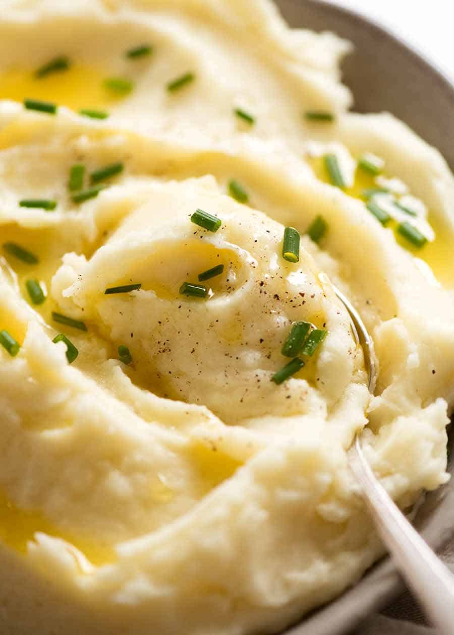 Close up of spoon scooping up Mashed Potato