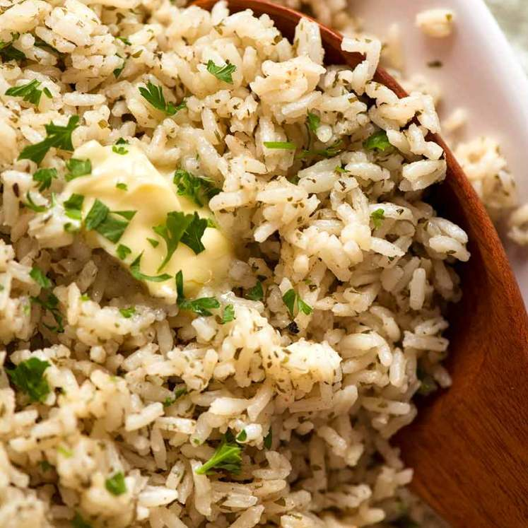 Close up of seasoned rice with butter, ready to be served (copycat boxed rice)