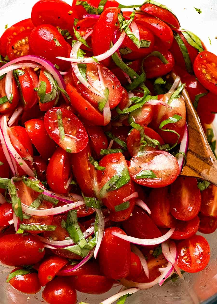Close up of juicy Tomato Salad with Basil, ready to be served