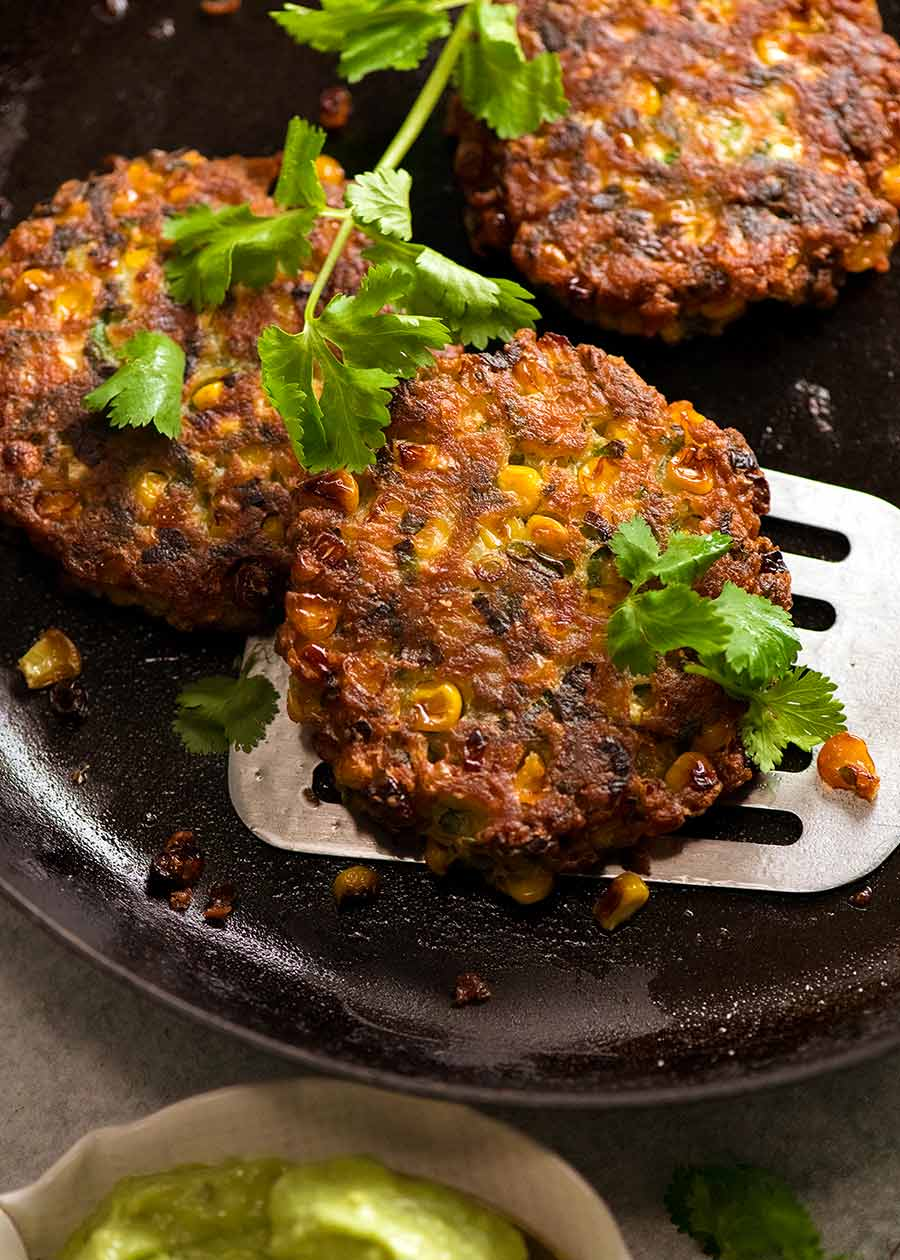 Freshly cooked Crispy Corn Fritters in a skillet