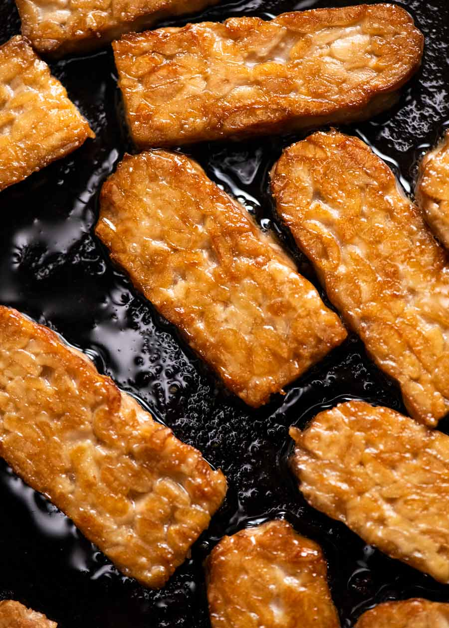 Close up of crispy pan fried tempeh