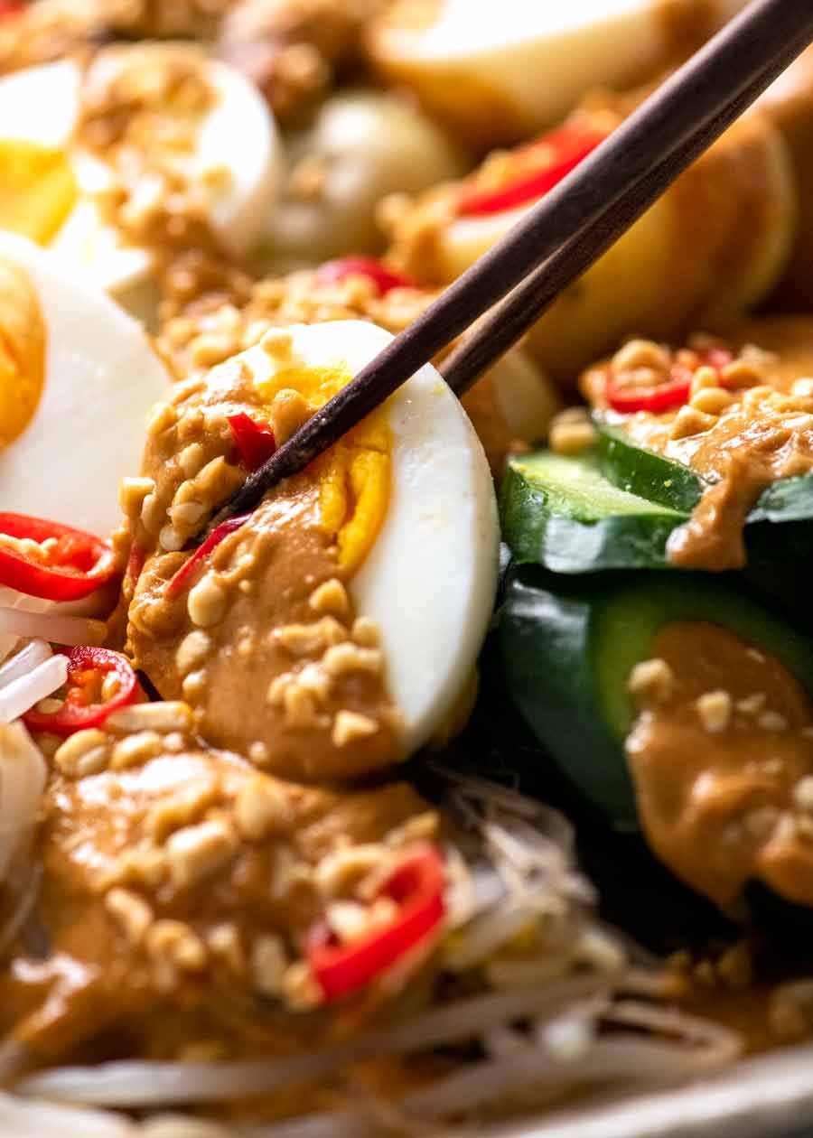 Close up of egg with Gado Gado peanut sauce