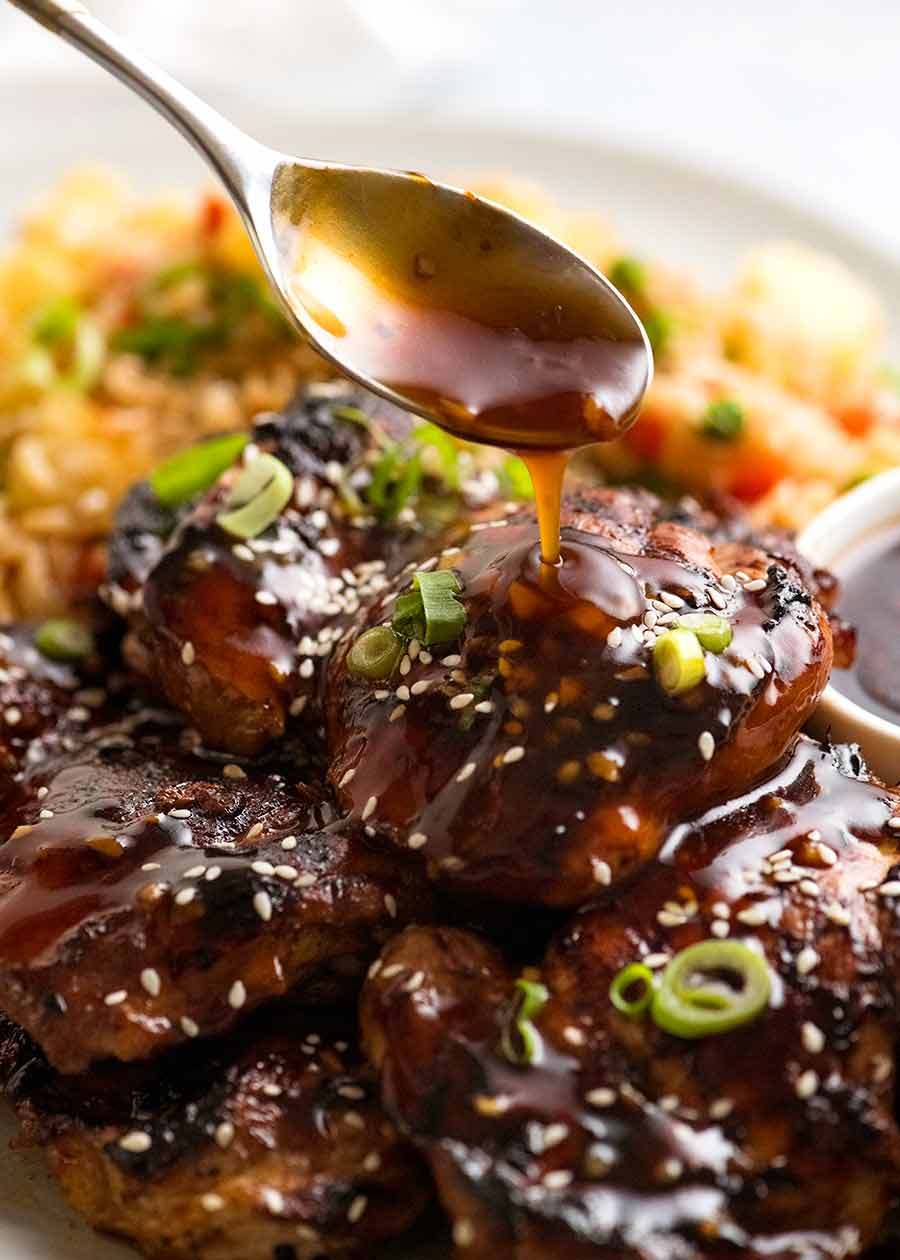 Pour honey soy sauce over chicken
