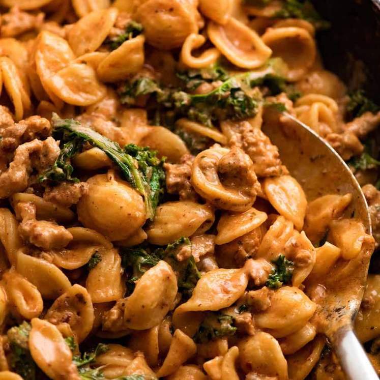 Close up of Orecchiette Sausage Pasta in Creamy Tomato Sauce in skillet, ready to be served