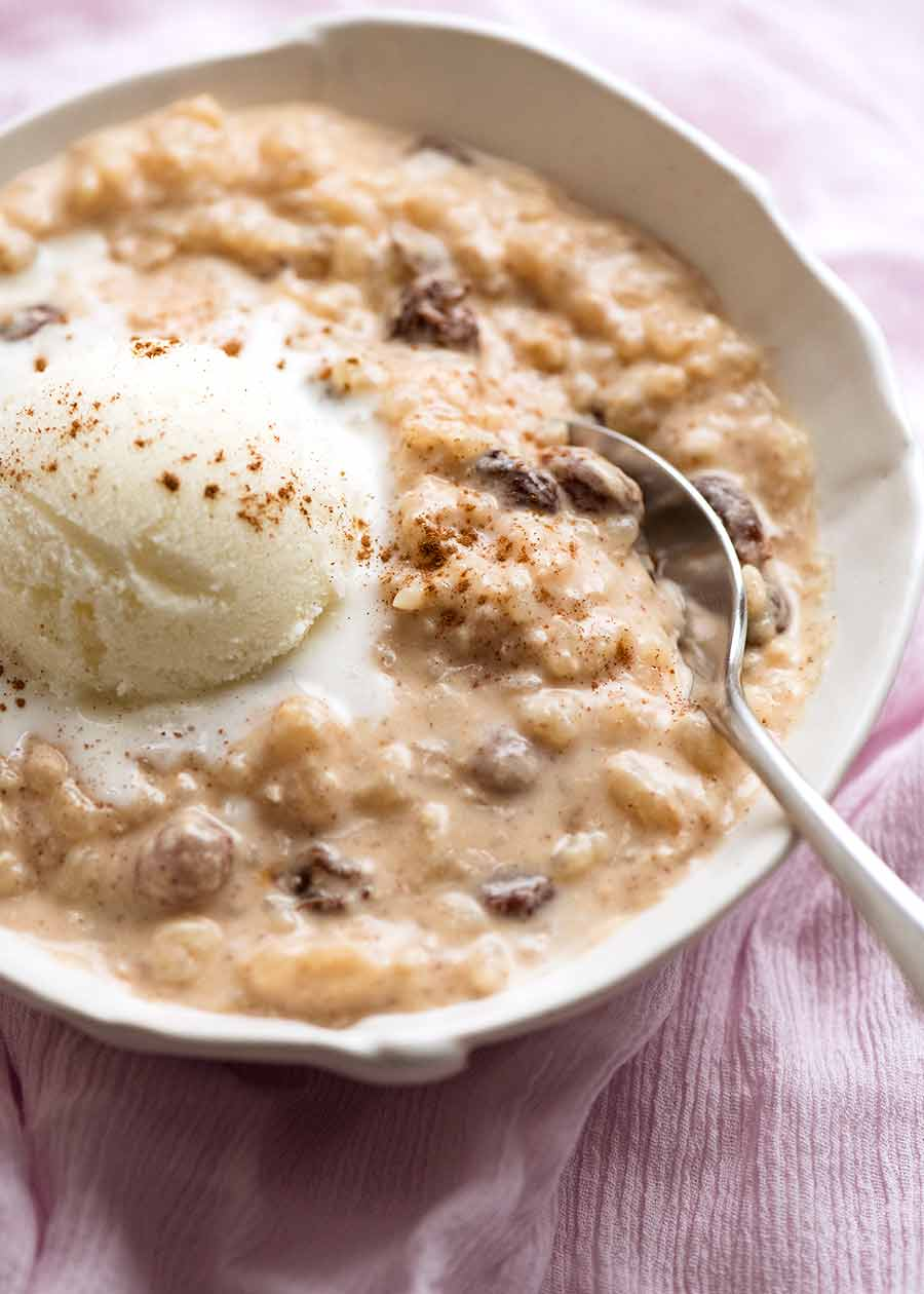 Creamy rice pudding in a bowl with ice cream, ready to be eaten
