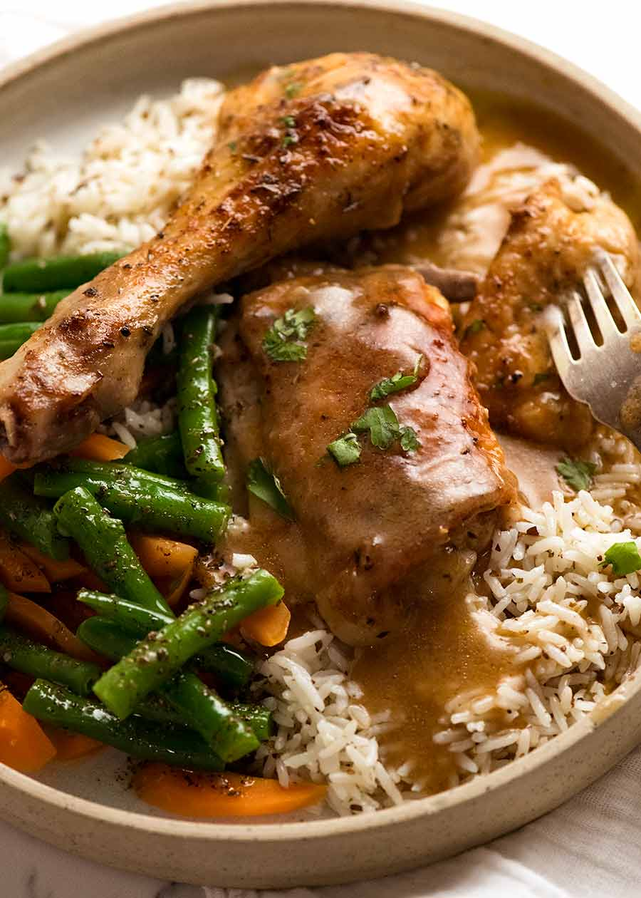 Gravy Baked Chicken served with seasoned rice and steamed vegetables