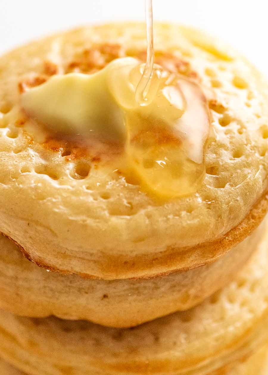 Drizzling butter on homemade crumpets