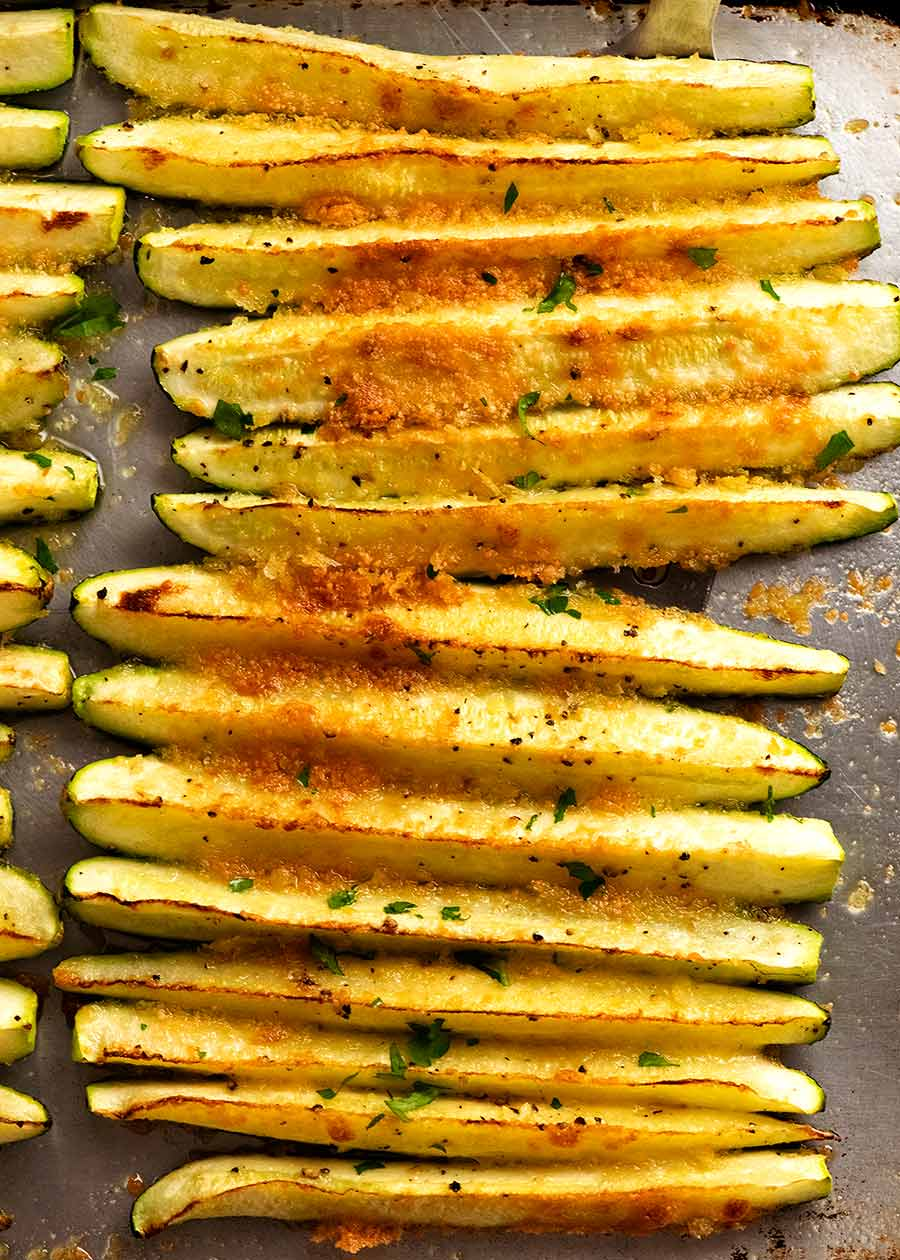Quick baked zucchini on a tray, fresh out of the oven