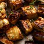 Close up of roasted eggplant cubes