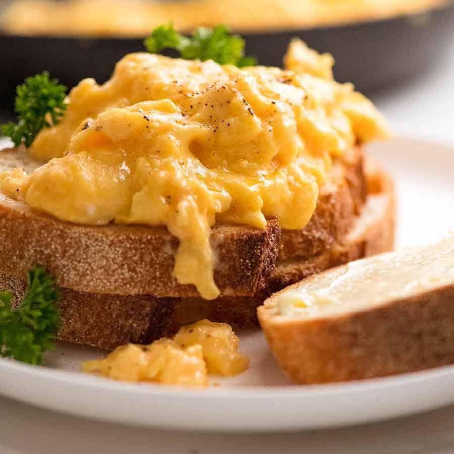 Soft, custardy scrambled eggs piled onto toast