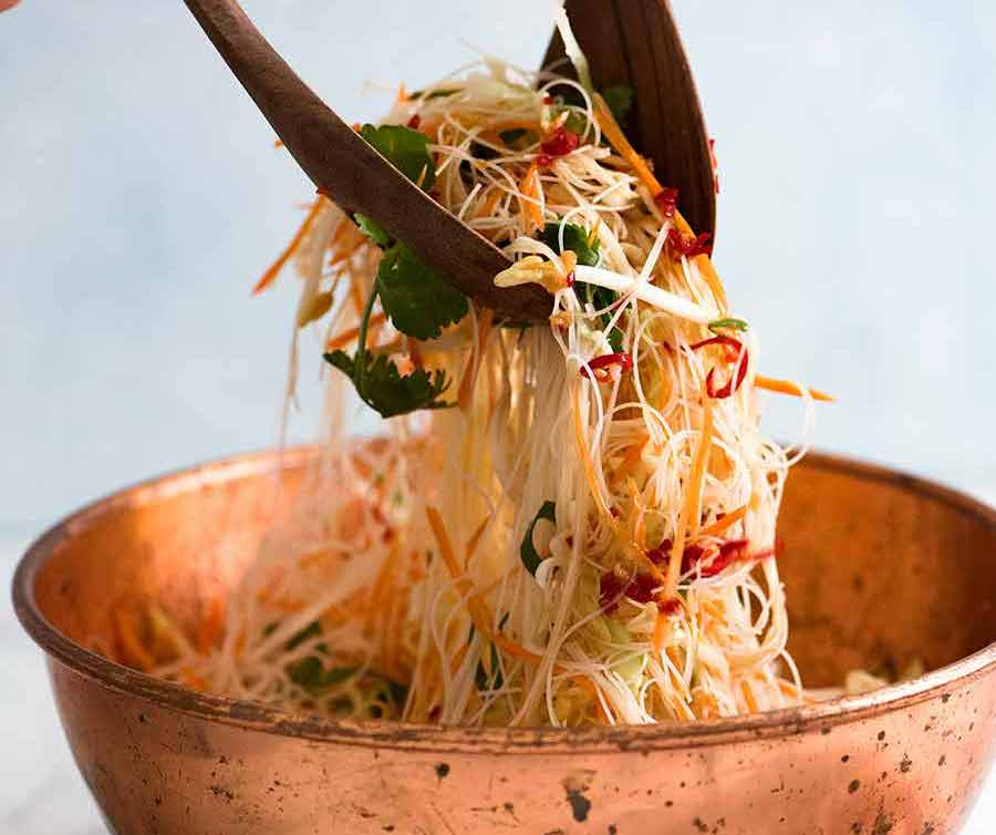 Vermicelli Noodle Salad being tossed in bowl
