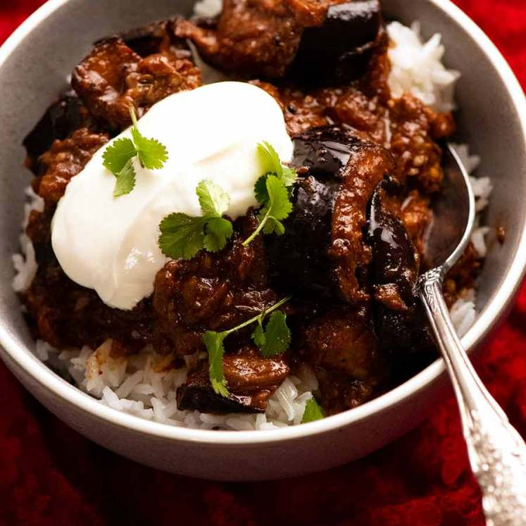 Bowl of Indian eggplant curry on rice
