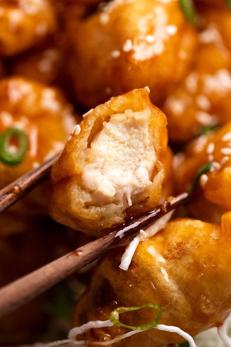 Close up showing inside of crispy Honey Chicken