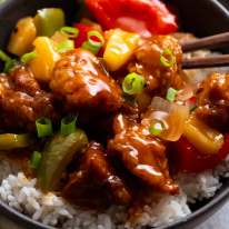 Sweet and Sour Pork in a bowl, ready to be eaten