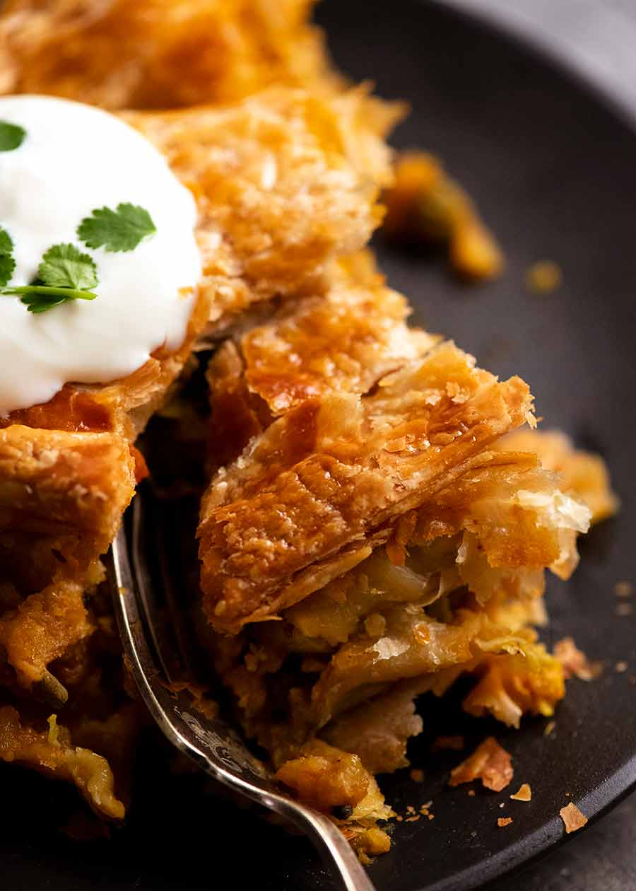 Close up of flaky puff pastry of Vegetable Samosa Pie