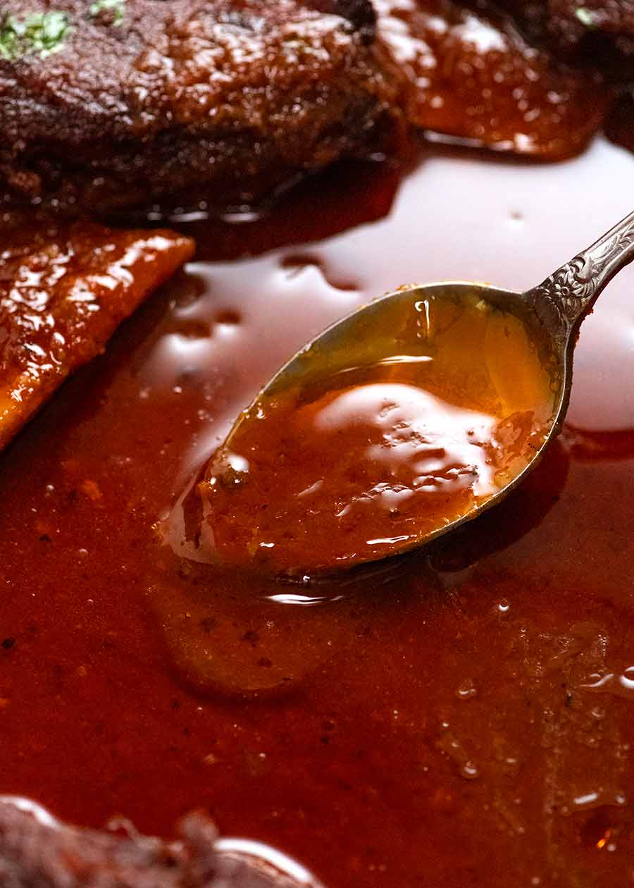 Spoon scooping up BBQ sauce for beef ribs