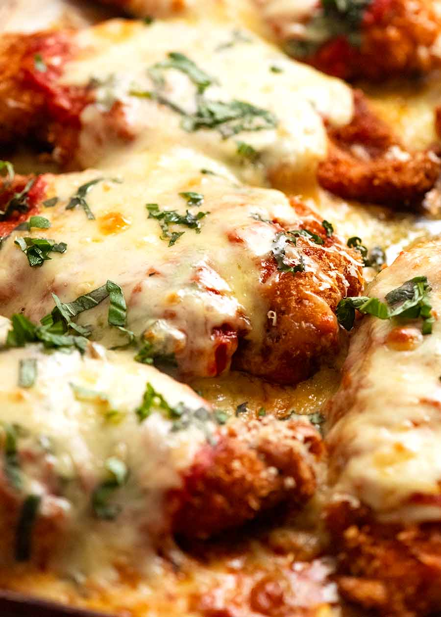 Close up of tray of Chicken Parmigiana (Chicken Parmesan), fresh out of the oven