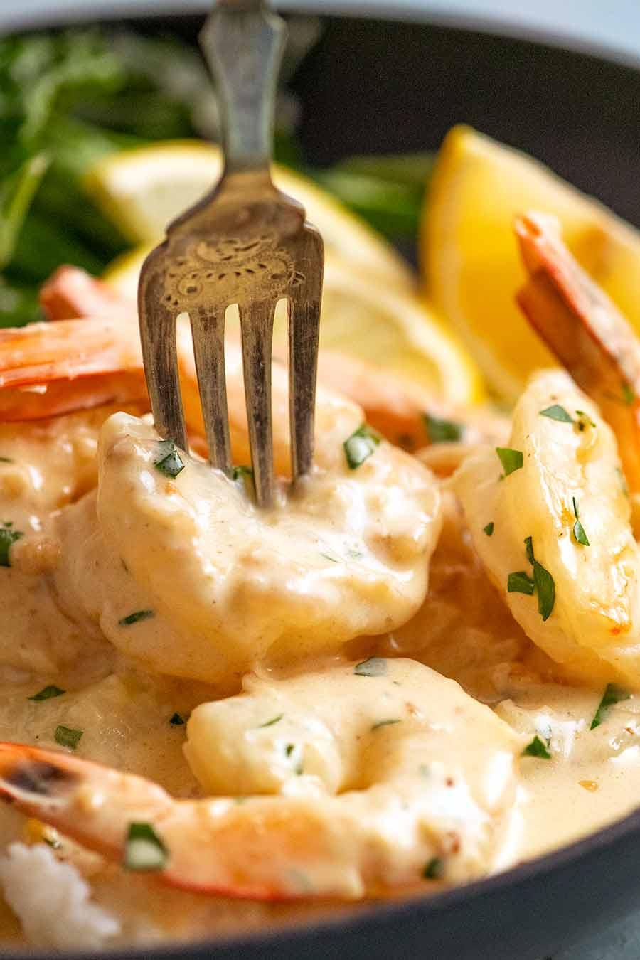 Fork picking up a Creamy Garlic Prawns (Shrimp)