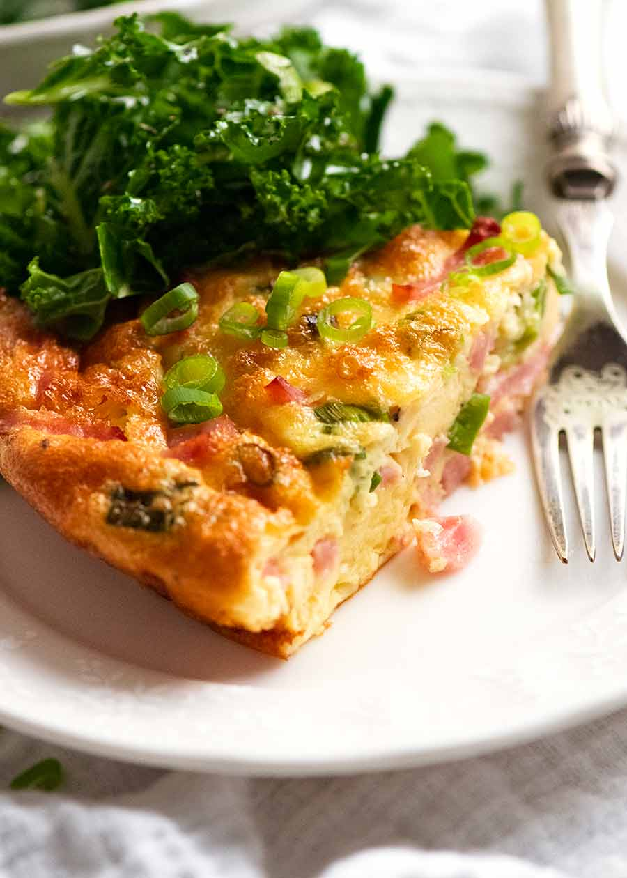 Crustless Quiche on a plate with a side salad