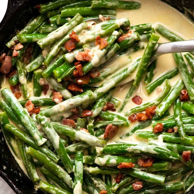 Overhead photo of Green beans in creamy parmesan sauce with bacon