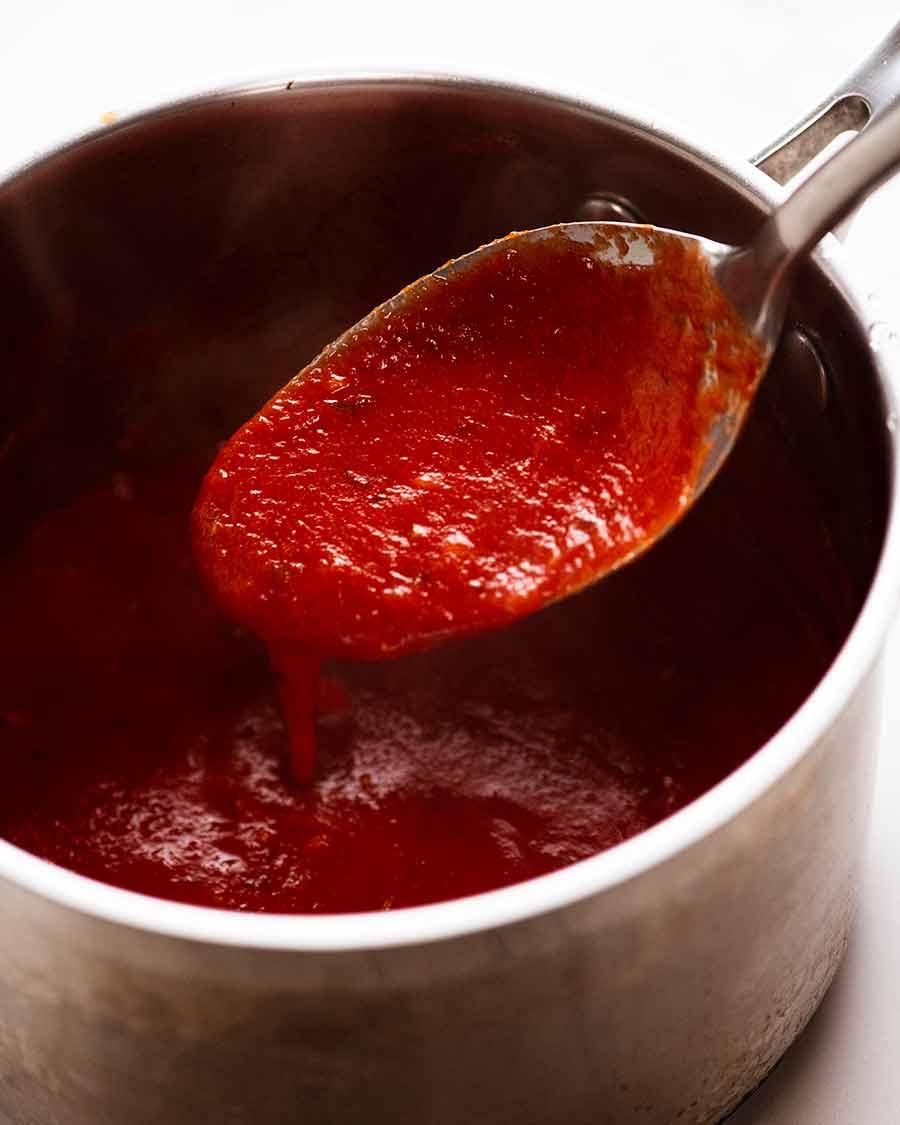 Chicken Parmigiana (Chicken Parmesan) Tomato Sauce in a saucepan