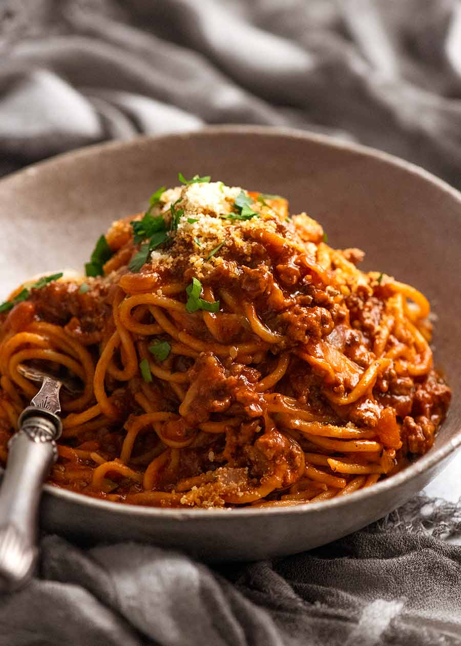 Bowl of One Pot Pasta Bolognese garnished with parmesan, ready to be eaten