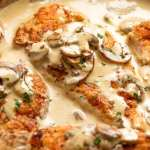 Chicken in Creamy Mushroom sauce in a skillet, ready to be served