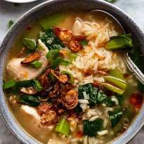 Chinese Rice soup in a bowl, ready to be eaten - quick and easy soup