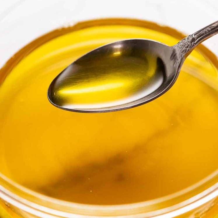 Spoon scooping up homemade ghee
