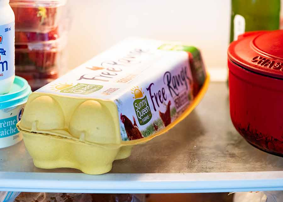 Photo of carton of eggs in fridge
