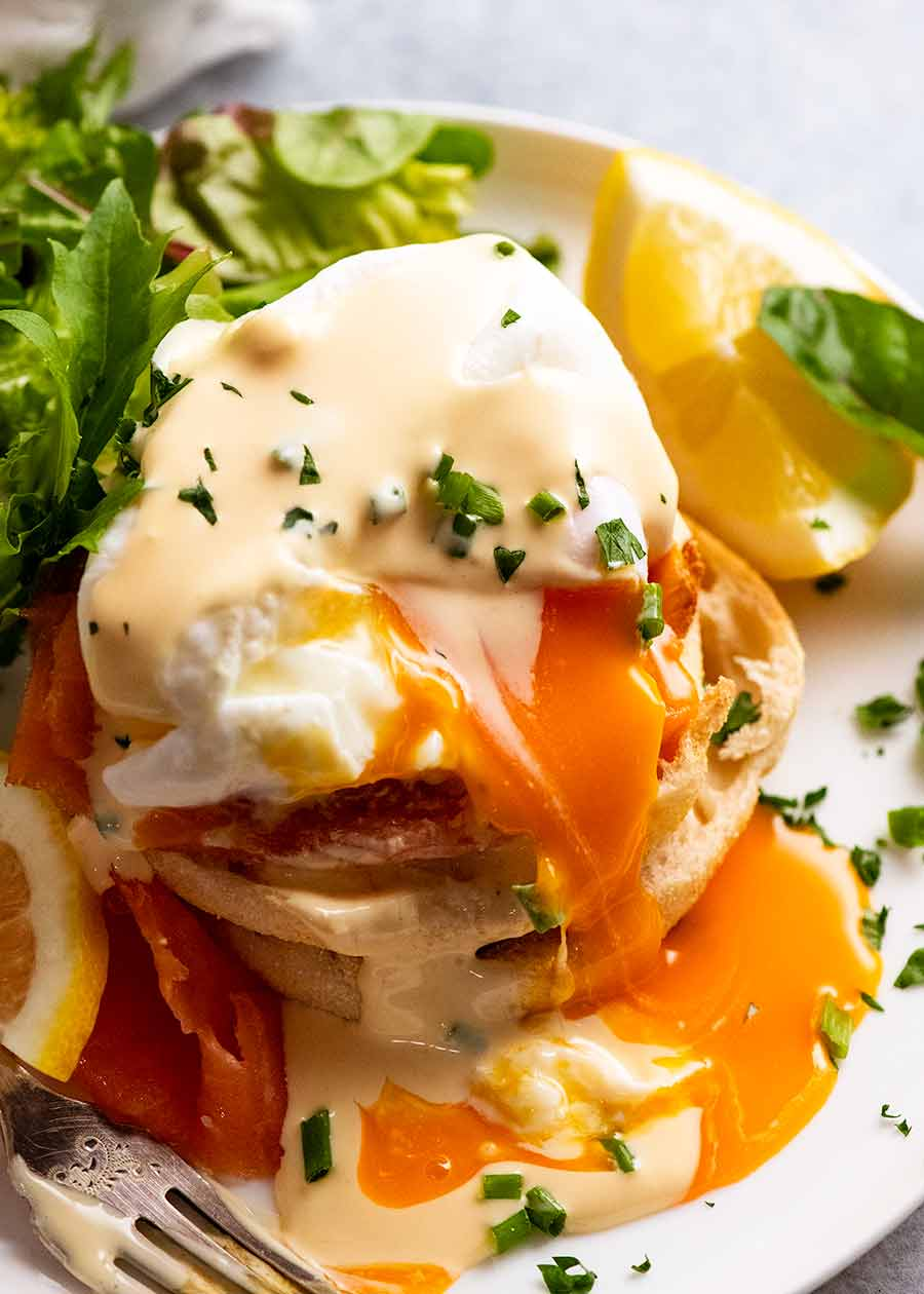 Eggs Benedict on a plate showing runny yolk inside