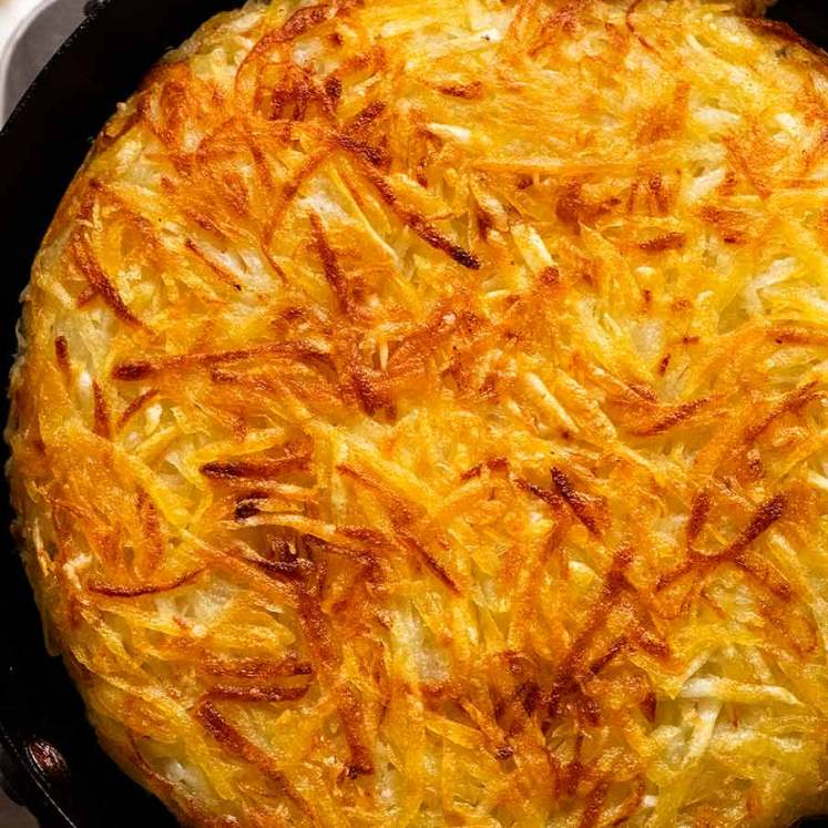 Potato Rosti in a skillet, fresh off the stove