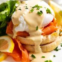 Eggs Benedict with smoked salmon on a plate, ready to be eaten