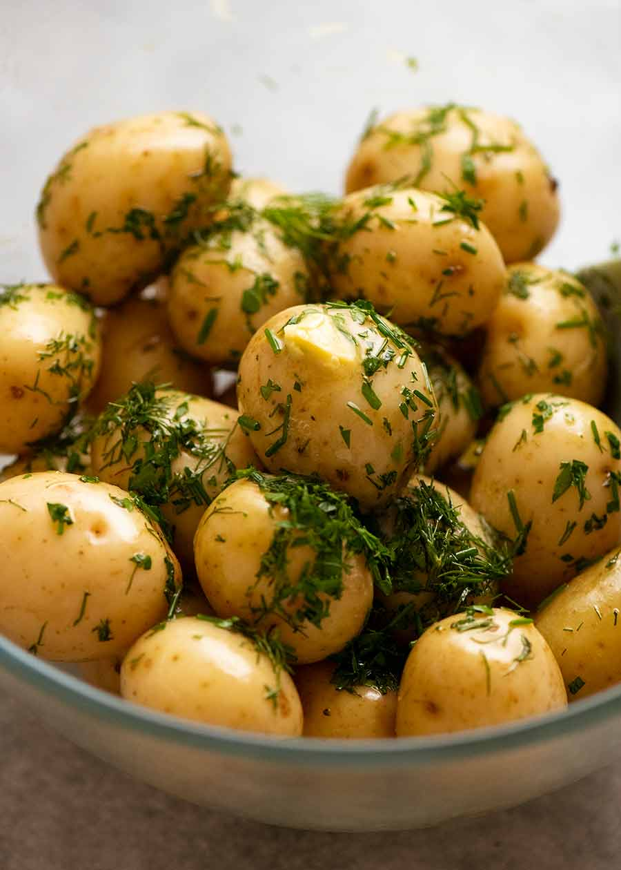 Baby Potatoes with Butter & Herbs in a bowl ready to be served