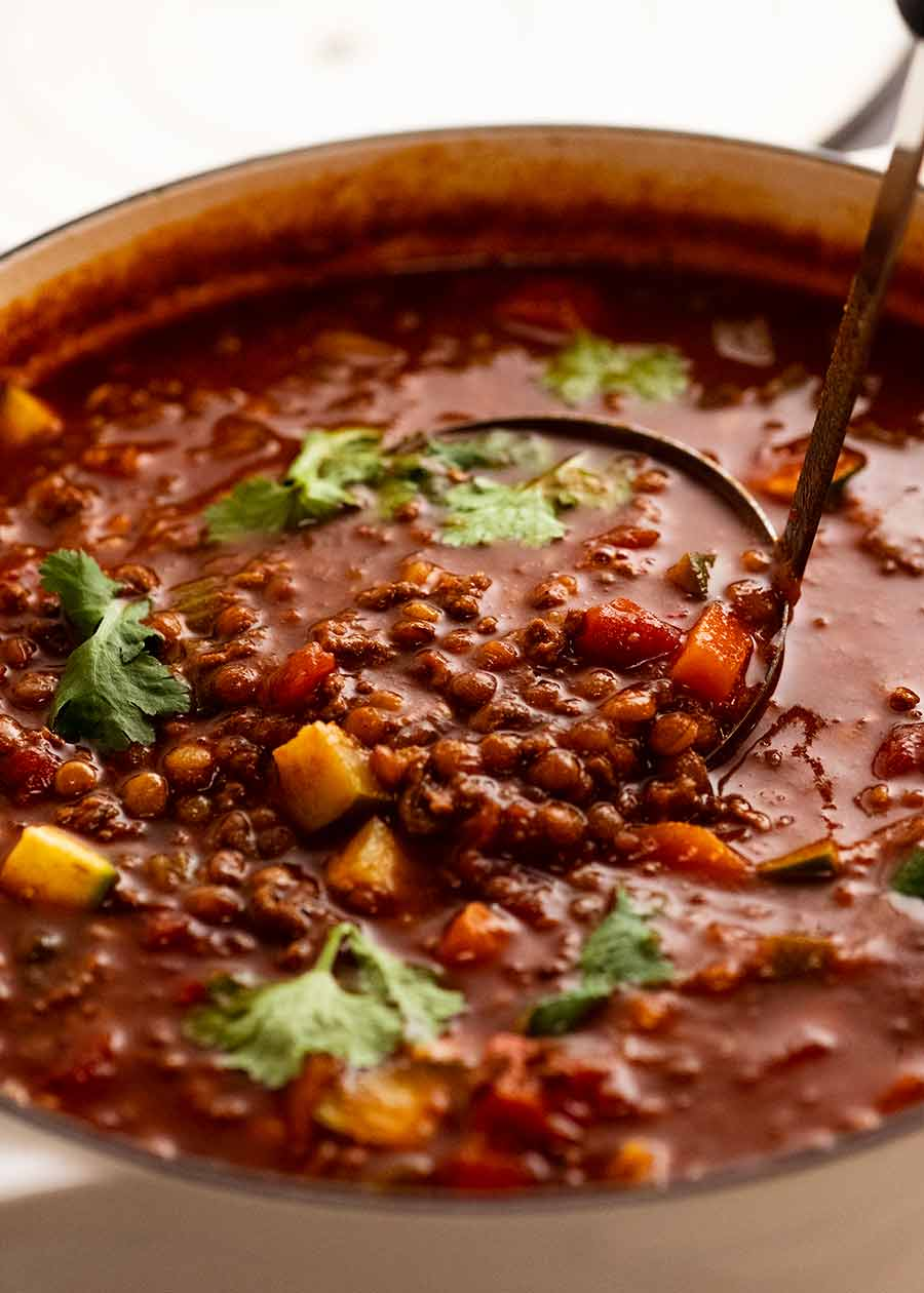 Close up of pot of Beef and Lentil Soup made with ground beef / beef mince, fresh off the stove