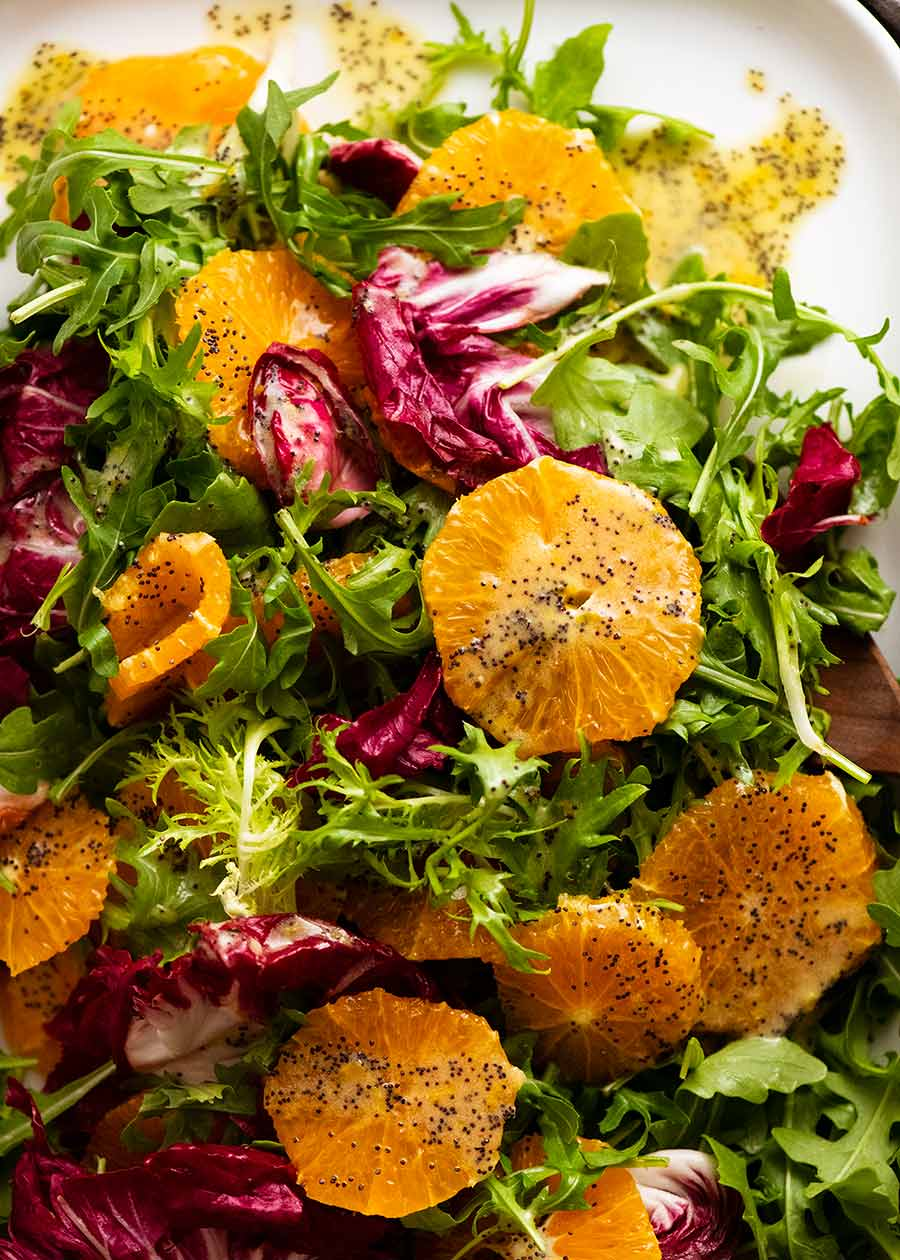 Overhead close up photo of Bitter Leaf and Orange Salad with Orange Poppyseed Dressing