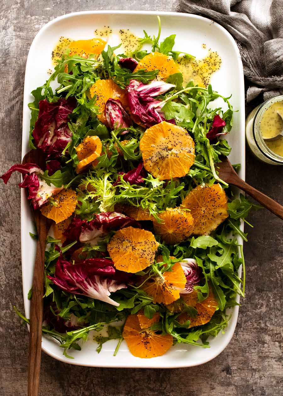 Bitter Leaf and Orange Salad with Orange Poppyseed Dressing on a plate ready to be served