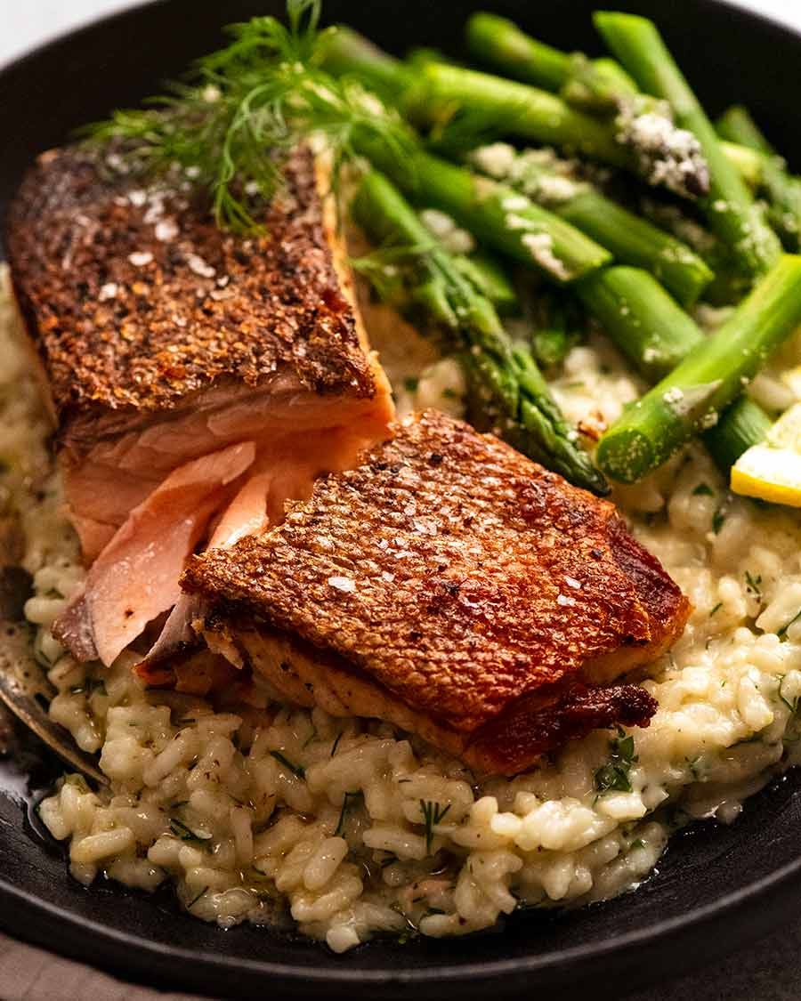 Plate of creamy risotto with crispy salmon