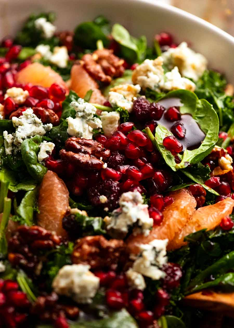 Close up of Pomegranate Salad with Baby spinach kale and honey candied walnuts