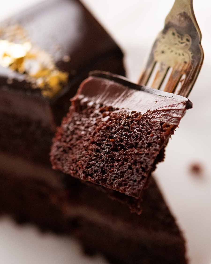Eating Chocolate Mirror Glaze Cake with fork
