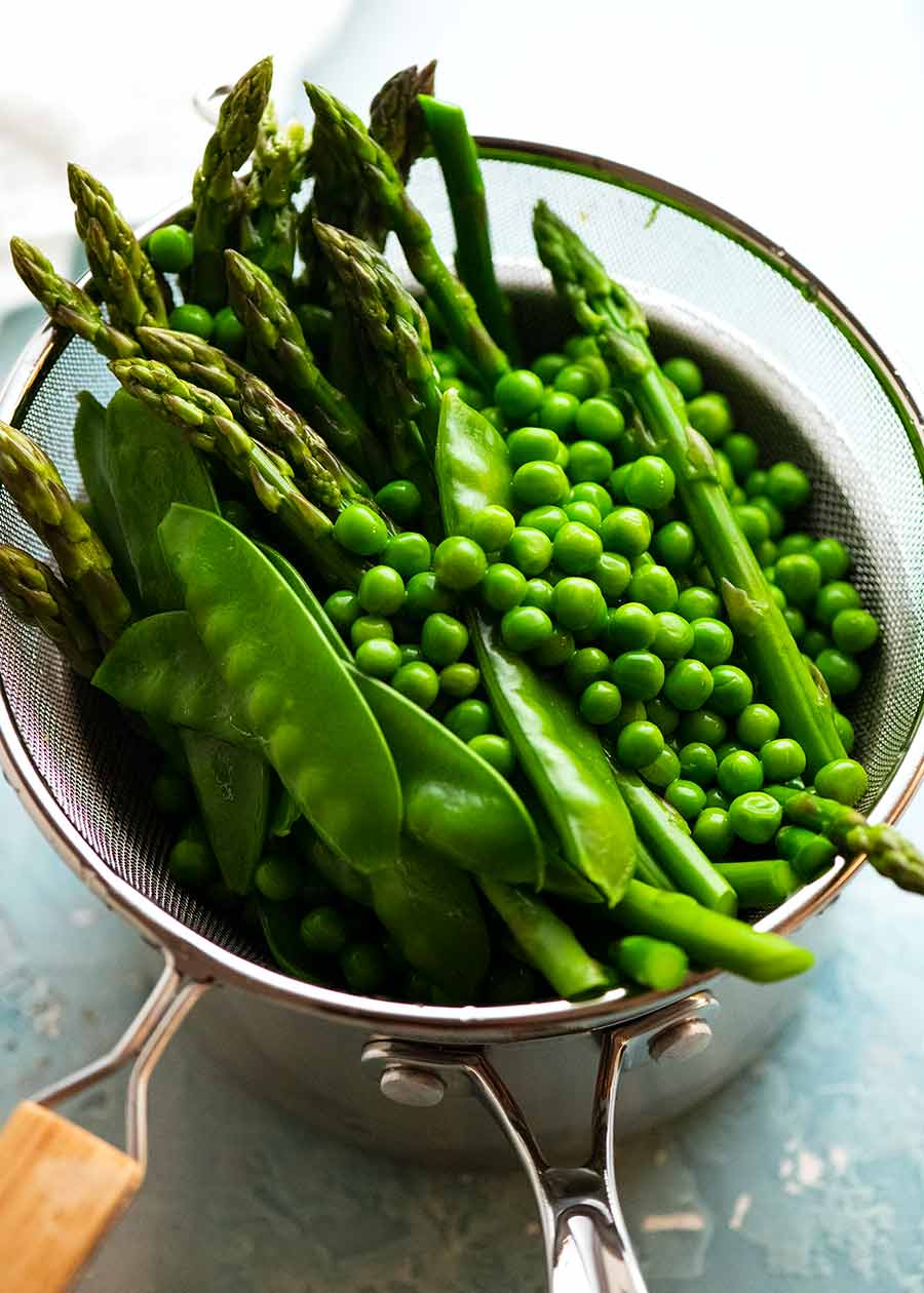 Blanched peas, asparagus and snow peas for Spring Salad