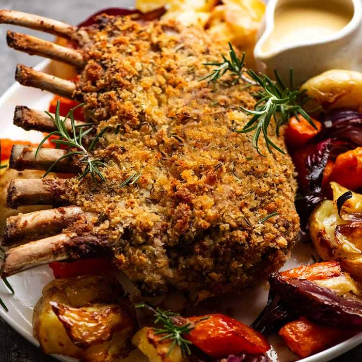 Rosemary Crumbed Rack of Lamb on a plate with roasted vegetables
