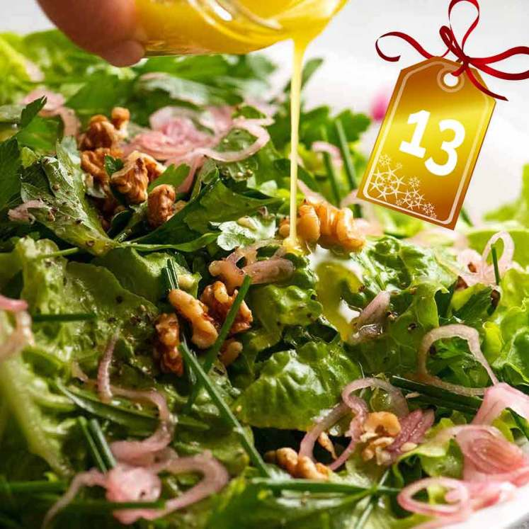 Drizzling lemon dressing over French Bistro Salad