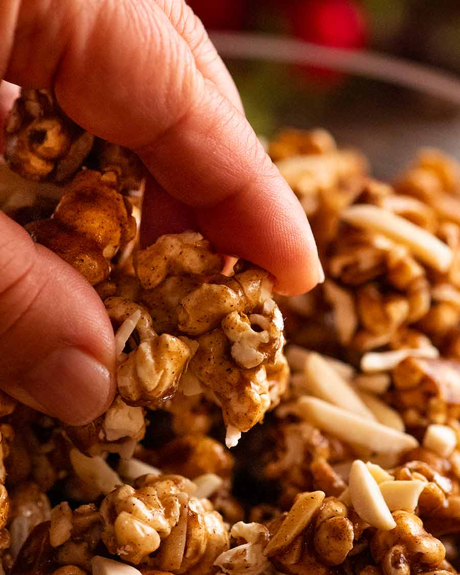 Close up of hand picking up Christmas Popcorn Candy
