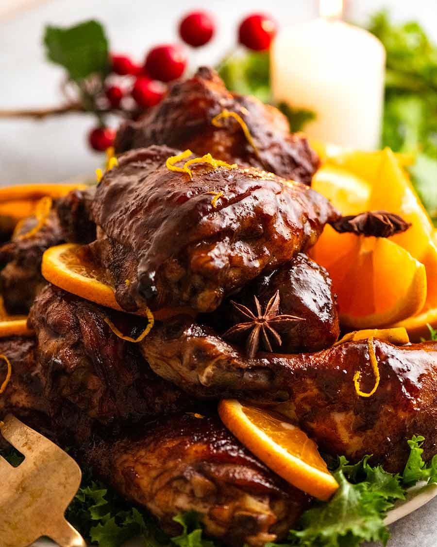 Close up of pile of Sticky Glazed Christmas Chicken