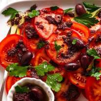 Close up overhead photo of Tomato Salad with Olive Tapenade
