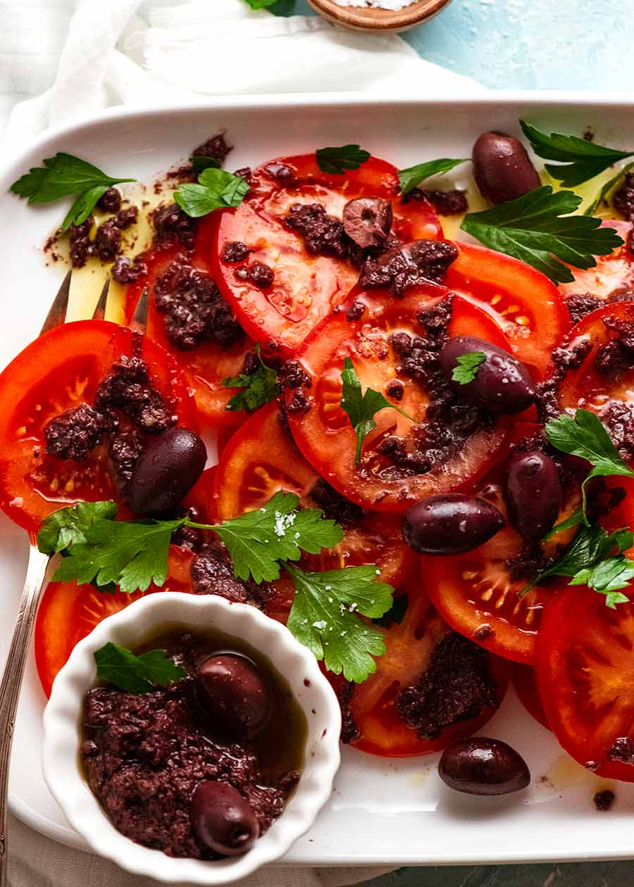Tomato Salad with Olive Tapenade on a platter