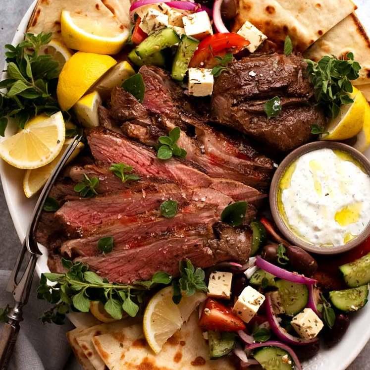 Greek Butterflied Lamb Leg on a platter, ready to be shared
