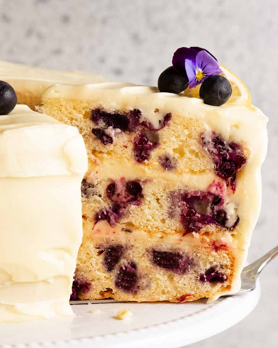 Slice of Blueberry Cake with Lemon Cream Cheese Frosting on a plate